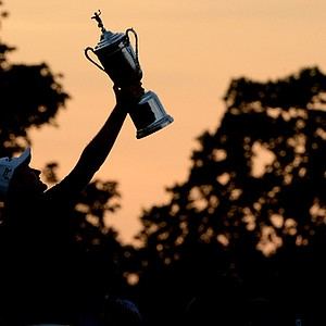 Justin Rose of England celebrates with the U.S. Open trophy after winning the U.S. Open at Merion Golf Club.
