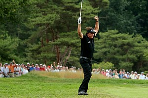 Phil Mickelson celebrates making a shot for eagle on the par -4 10th hole during the final round of the U.S. Open at Merion Golf Club.