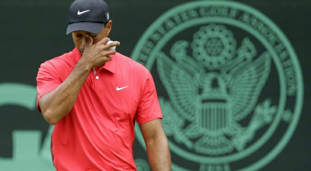 Tiger Woods reacts after putting on the eighth green during the fourth round of the U.S. Open.