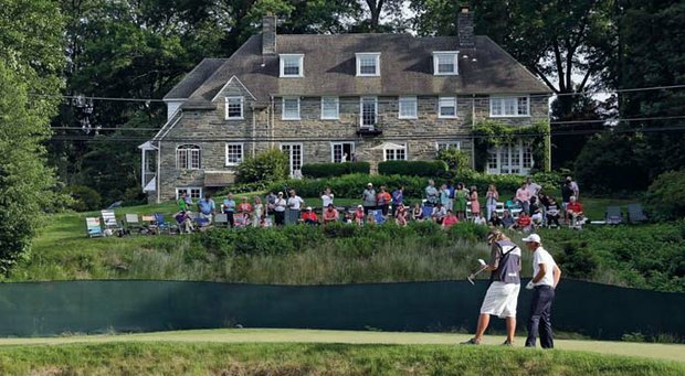 Local spectators watch Nicolas Colsaerts at No. 11 during the U.S. Open at Merion Golf Club.