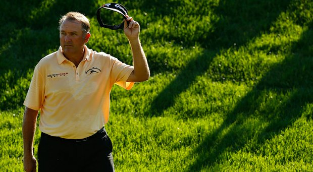 Ken Duke acknowledges the crowd as he walks onto the 18th green during the final round of the Travelers Championship.