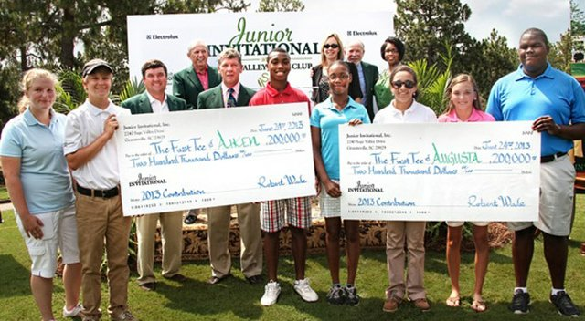 The Junior Invitational at Sage Valley presents the checks to The First Tee.