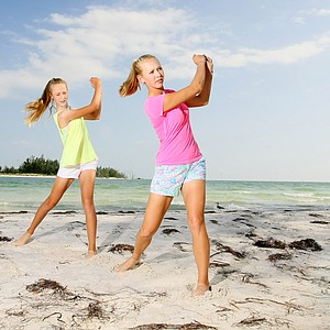 Jessica and Nelly Korda at Coquina Beach in Bradenton Beach, the girls playfully work on their sand shots.