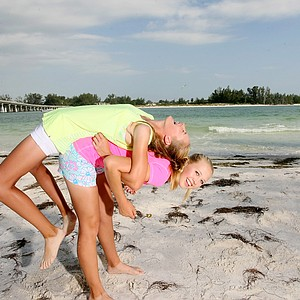 Jessica and Nelly Korda horse around with each other at Coquina Beach in Bradenton Beach.