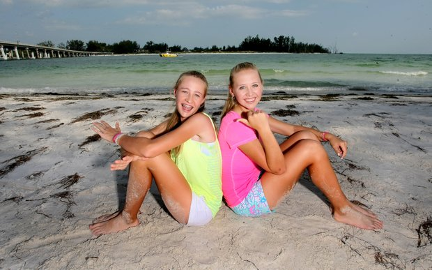Jessica and Nelly Korda at Coquina Beach in Bradenton Beach, Fla. The Korda sisters, Jessica, 20 and Nelly, 14 are playing the U. S. Women's Open this week.