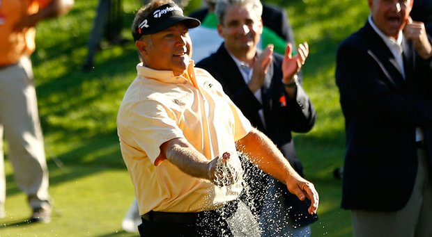 Ken Duke celebrates by spraying Coca-Cola all over the 18th green after winning the Travelers Championship.