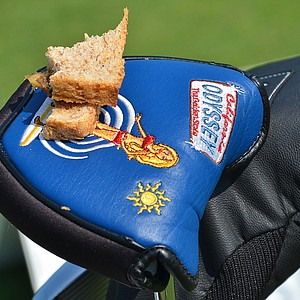 Luke List used his bikini-clad Odyssey putter headcover as a sandwich plate while practicing on the range.
