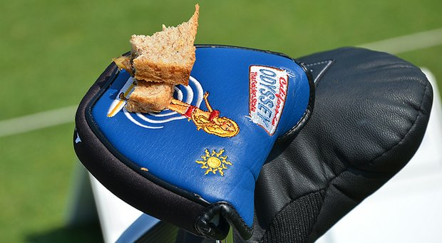 Luke List used his bikini-clad Odyssey putter headcover as a sandwich plate while practicing on the range at Congressional for the 2013 AT&T National.