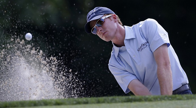 Roberto Castro hits out of a bunker on the 12th hole during the second round of the AT&T National at Congressional.