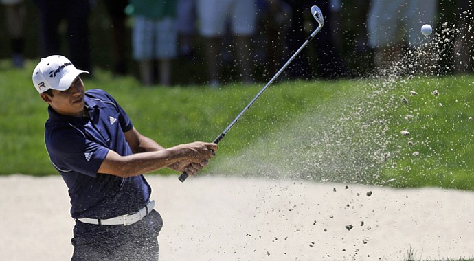 Andres Romero, of Argentina, chips onto the first green from a bunker during the third round of the AT&T National at Congressional in Bethesda, Md.