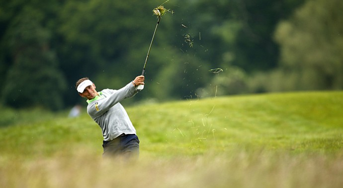 Joost Luiten of the Netherlands plays out of the rough on the second hole during round three of the Irish Open.