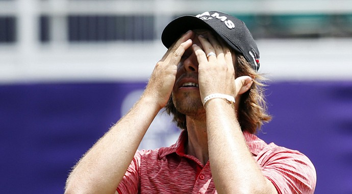 Aaron Baddeley of Australia reacts after missing a putt on No. 18 during the first round of the 2013 St. Jude Classic, where he missed the cut.