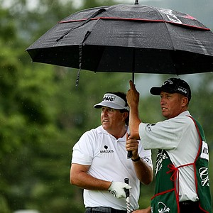 """Phil Mickelson watches a shot with his caddie Jim """"Bones"""" MacKay at No. 17 on the Old White course. Mickelson played in the Old White Pro-Am with Jim Justice, the owner of The Greenbrier, and West Virginia senator Joe Manchin."""