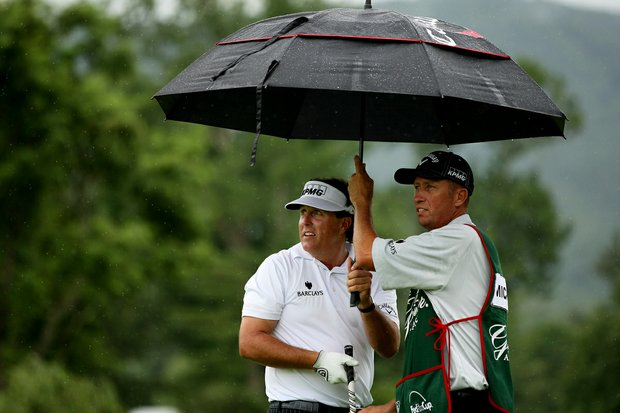 "Phil Mickelson watches a shot with his caddie Jim ""Bones"" MacKay at No. 17 on the Old White course. Mickelson played in the Old White Pro-Am with Jim Justice, the owner of The Greenbrier, and West Virginia senator Joe Manchin."