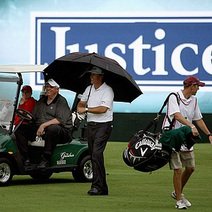 Phil Mickelson walks alongside Jim Justice while playing in the Old White Pro-Am.