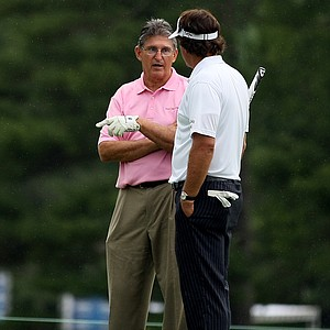 Phil Mickelson chats with West Virginia senator Joe Manchin while playing in the Old White Pro-Am with Jim Justice, the owner of The Greenbrier.