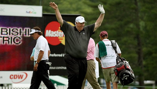 Phil Mickelson played in the Old White Pro-Am with Jim Justice, the owner of The Greenbrier. Justice threw his hands in the air to the fans as they leave No. 18.
