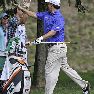 Johnson Wagner gives a high five to his caddie after an eagle on the 12th hole during the first round of the Greenbrier Classic.