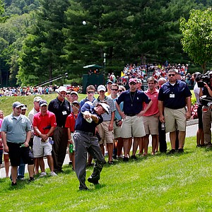 Phil Mickelson hits his second shot on the seventh hole during the first round of the Greenbrier Classic.
