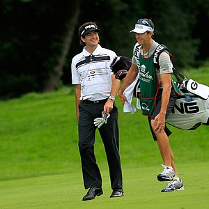 Bubba Watson walks down the 12th fairway with his caddie during round two of the Greenbrier Classic.