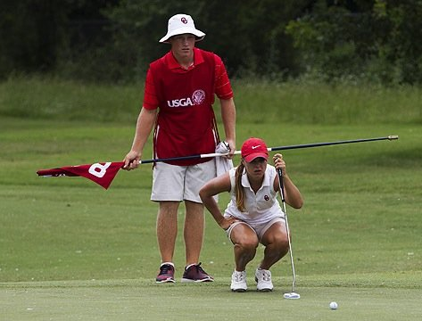 Brad Dalke helps Oklahoma golfer A.C. Tanguay read a putt during the U.S. Women's Amateur Public Links.