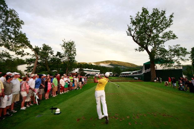 Jonas Blixt of Sweden watches his tee shot on the 18th hole during the final round of the Greenbrier Classic.