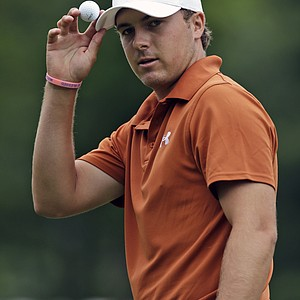 Jordan Spieth gestures to the crowd on the first hole during the final round of the Greenbrier Classic.