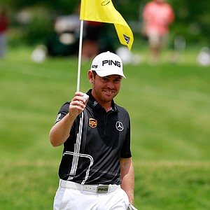 Louis Oosthuizen reacts after pulling the ball out of the hole following and eagle on the second hole during the final round of the Greenbrier Classic.