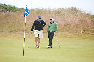 Alex Miceli talks with European Ryder Cup captain Paul McGinley during Wednesday's Pro-Am at the Scottish Open.