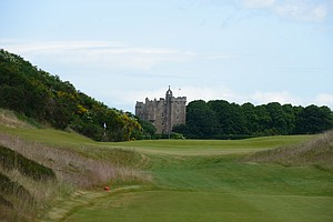 The castle is seen in the distance from the fourth hole at Castle Stuart.