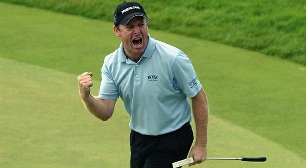 Gary Evans celebrates on the 17th green during the final round of the 131st Open Championships at Muirfield Golf Club.