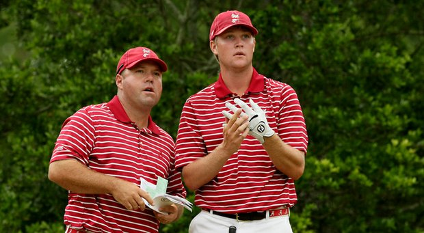 Rob Bradley, left, has been named men's golf coach at Purdue.