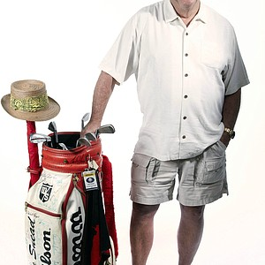"""This July 11, 2013 photo taken in Dallas, Texas and provided by Heritage Auctions shows Sam Snead's son, Jack, with a set of his father's golf clubs and Wilson bag used in the 1960s and 1970s. The clubs and bag are among 14 lots from the Sam Snead Collection that will be the centerpiece of Heritage Auctions' offerings next month in Chicago. """"We consider it the most significant golf collection that's ever been offered,"""" said Chris Ivy, director of sports at Heritage Auctions."""