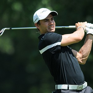Camilo Villegas hits his second shot on the 18th hole during the John Deere Classic.