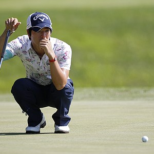 Ryo Ishikawa lines up a putt during the first round of the John Deere Classic.