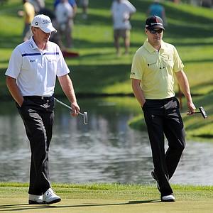 Steve Stricker, left, and Zach Johnson walk on the 18th green during the John Deere Classic.