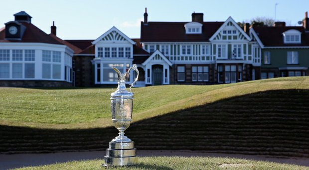The Claret Jug trophy beside the 18th green in front of the clubhouse prior to The Open Championship at Muirfield.