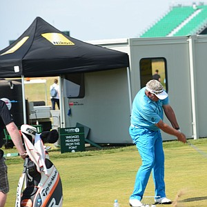 Darren Clarke works on a swing change on the range at Muirfield ahead of the 2013 Open Championship.