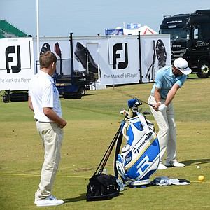 Dustin Johnson works on his swing on the range at Muirfield ahead of the 2013 Open Championship.