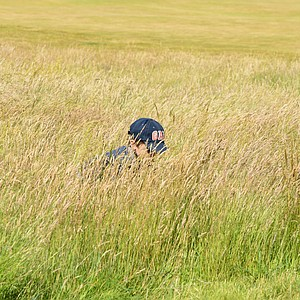 Crossing from the one side of the 18th hole at Muirfield to the other, this little boy was playing in the weeds off the 18th hole and was barely visable at the time.