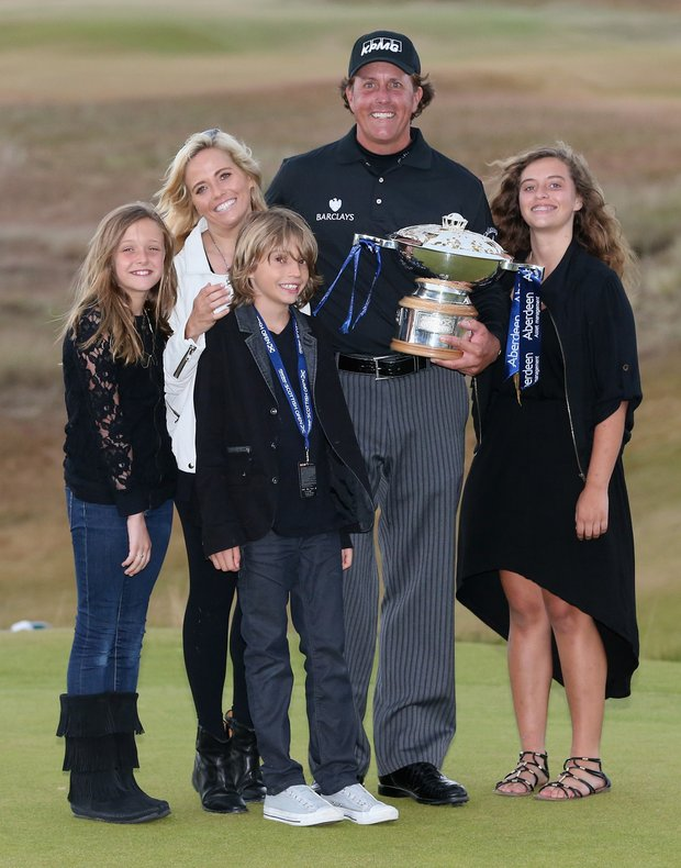 Phil Mickelson poses with the trophy and his wife Amy and children Evan, Amanda (right) and Sophia after his victory on the first hole of a sudden-death playoff during the final round of the Scottish Open at Castle Stuart.