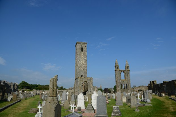 The famous St. Andrews graveyard with St. Rule Tower prominently displayed.
