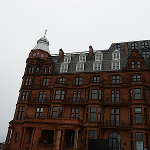 A look at Hamilton Hall at St. Andrews, a former dorm for university students. Herb Kohler ended up with the property and sunk a bunch of money into the property and is now selling flats in the hall.  The penthouse is rumored to be 7.5 million pounds.