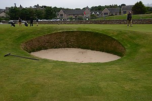 Notice the Road Hole bunker at St. Andrews is no longer round, but oval or oblong and not as deep as the old bunker.