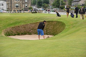 A golfer in the new 17th hole Road Hole bunker at St. Andrews.