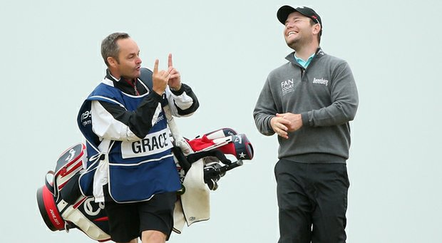 Branden Grace chats with his caddie Billy Foster prior to the Scottish Open. Grace would eventually lose in a sudden-death playoff in the duo's first tournament together.