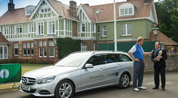 Ernie Els returns the Claret Jug to the R&A's Peter Dawson prior to the official start of the 2013 Open Championship.