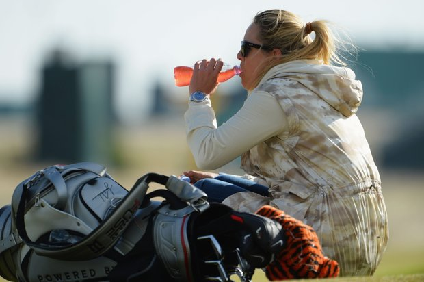 Skier Lindsey Vonn watches Tiger Woods ahead of the Open Championship at Muirfield.