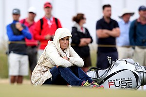 Lindsey Vonn watches her boyfriend Tiger Woods during a practice round for the Open Championship at Muirfield.