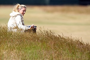 Lindsey Vonn, girlfriend of Tiger Woods, takes a picture as she attends a practice round for the 2013 Open Championship at Muirfield.